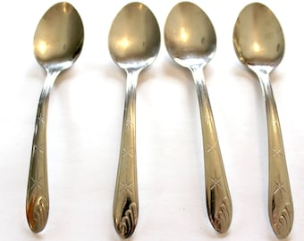 Lot of 4 Star and Swirl Tablespoons Stainless flatware silverware design name?