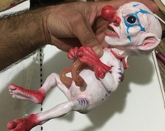 BROKEN clown sculpture