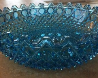 A Stunning azure blue pressed or cut glass bowl in hob and button pattern by Sowerby.