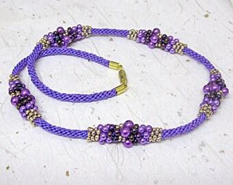 Beaded purple kumihimo necklace