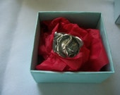 A beautiful rose ring handcrafted from antique and vintage silverware