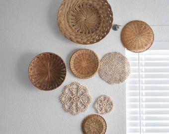 vintage set of 8 straw rattan wall baskets / seashell trivets / shells