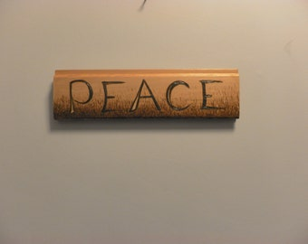 Peace  in the garden a peace sign scrap wood pyrography for the wall peaceful thoughts