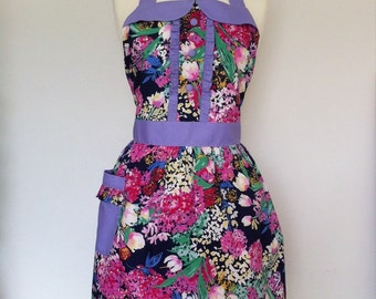 Retro apron, pink and purple flowers on a blue fabric, fully lined.
