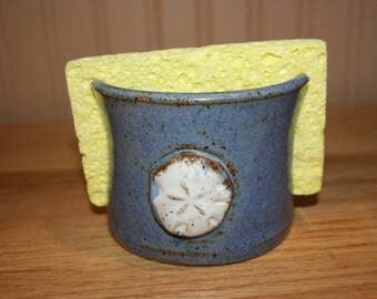Handmade blue pottery sponge holder with sand dollar design, napkin holder