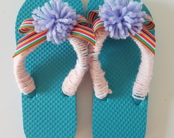 Girls Turquoise Flip Flop Crocheted with Light Pink Yarn and Multi Colored Bow and Pom Pom