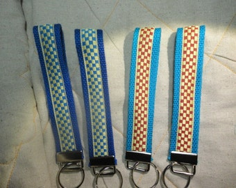 Fun Jacquard Woven Print Ribbon Key Fobs in Racing pattern in blue or red.