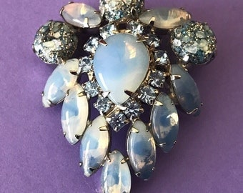 Moonstone Blue Moonglow Thermoset Lucite and Glitter Chabochon and Blue Rhinestone Brooch