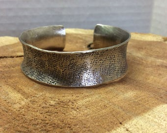 Blackened Sterling silver, anticlastic, hammered cuff