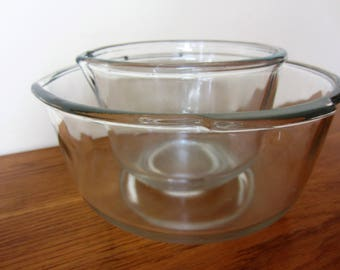Vintage pair of clear glass mixing bowls circa 1960s.
