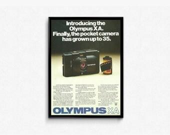 Olympus XA Camera • Pocket Camera • 1970s Photography • Full Frame Camera Ad • Camera Product Ad • Olympus A11 Unit • Handheld Retro Camera