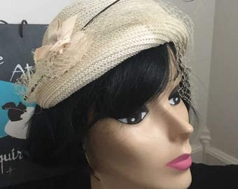 1953 Ladies white hat with veil and accent spray