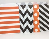 Mix and match black and orange candy bags.
