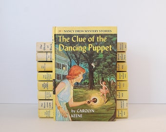 Nancy Drew Mystery, The Clue of The Dancing Puppet Nancy Drew Book by Carolyn Keene
