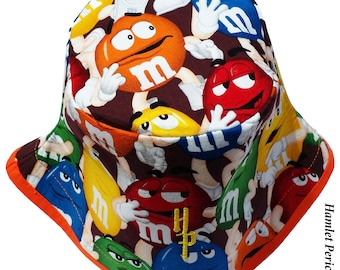 M&Ms Candy Bucket Hat | MandM Hat | Food Hat | Chocolate Candy | Orange Brim | Multicolored Unisex Small Hat by Hamlet Pericles | HP42716