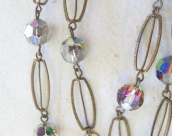 Vintage necklace with aurora borealis crystal