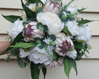 Wedding bouquet, gift or home decor flowers.  Proteas, peonies, blushing bride, wax flower, eucalyptus leaves. White, cream, blush flowers