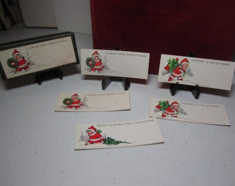 1920's unused embossed whitney made christmas gift cards in original box rosy cheeked babies in santa suits carry,tree,wreath,holly berry