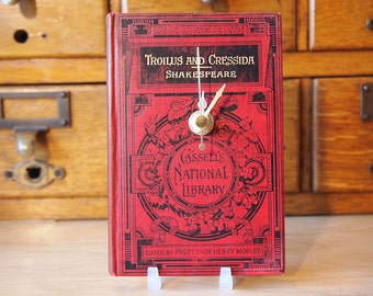 Shakespeare Victorian book clock. Made with an original edition of Troilus and Cressida from 1889. Red, black & gold.