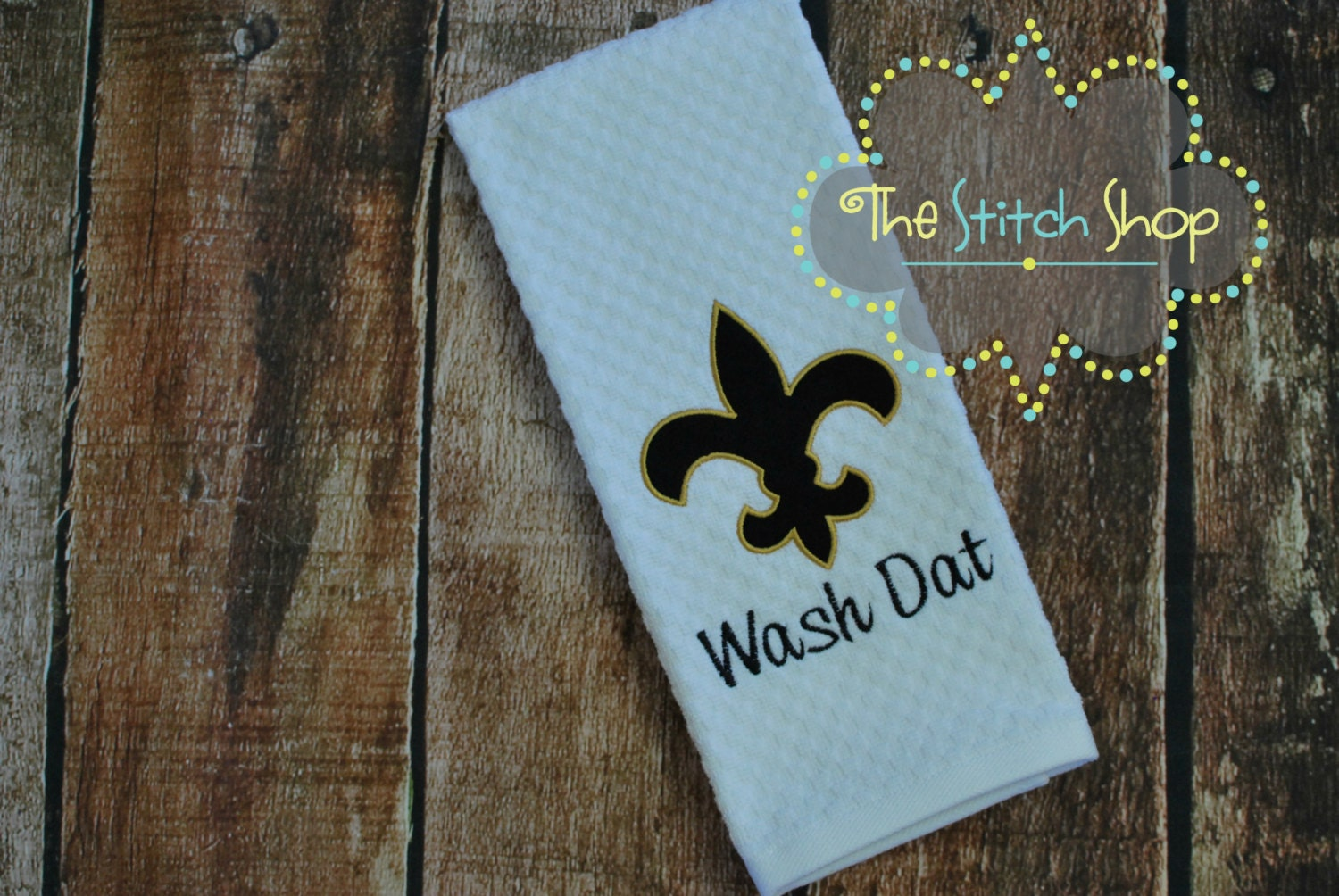appliqued and monogrammed new orleans saints dish towel with
