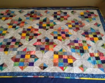 Handmade reversible twin quilt with a puppy