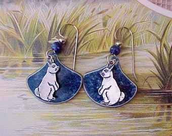 Unusual and Charming Pair of Earrings with Silver Bunnies on Lapis Colored Background