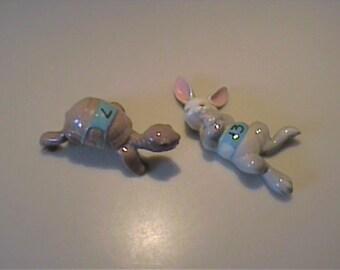 Vintage miniature Hagen Renaker racing tortoise and the hare