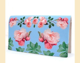 clutch bag with pink rose sprigs on blue placement print, handmade wedding clutch with optional personalisation