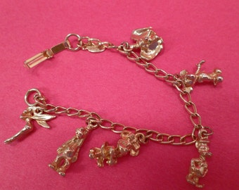Vintage Disney Charm Bracelet, Gold Tone Metal,  Vintage, Six Charms Including Mickey Mouse, Minnie Mouse and Donald Duck