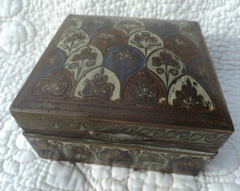 Small antique brass and enamel box that is lined in wood  with the date 1851 engraved on the bottom