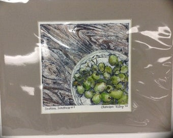 Southern Sweetness, collograph print with watercolor and mixed media. Still life of fruit grapes and plate on  rustic wood dining room table