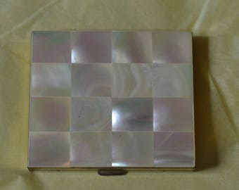 A Vintage Compact Whose Top is Made of Mother of Pearl