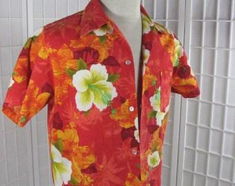 1960s  Orange Floral/ Hibiscus Hawaiian Shirt by Hukilau Fashions......  size Medium