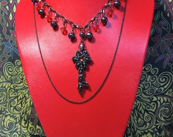 Renaissance style multi strand necklace in gun metal.
