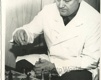 Man playing chess vintage photo