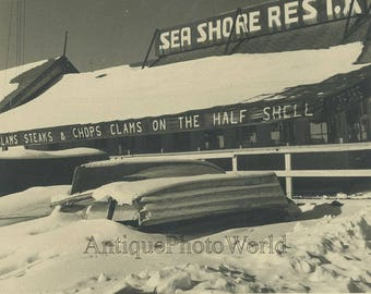 Boat covered in snow by restaurant vintage art photo