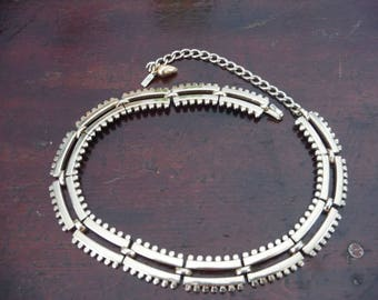 Monet adjustable choker necklace - brassy avant garde mid century modern look curved segmented bar and chain look - statement piece!