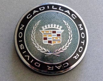 Vintage Cadillac Trunk lock cover Eldorado round Black Blue Teal part # 25604730