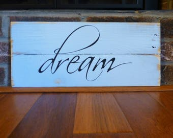 Dream sign hand painted on reclaimed wood