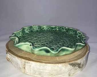 Circular green textured plate, fluted rim