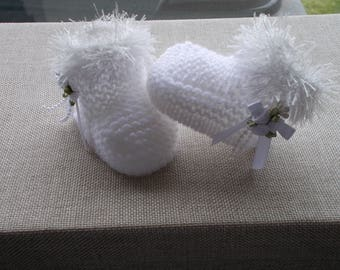 Hand knitted white baby girls booties