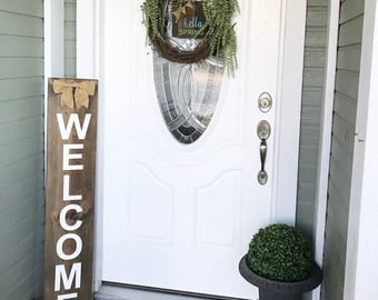 Welcome sign, front porch