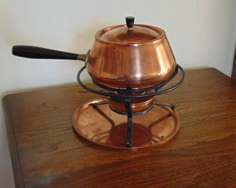 Vintage Swiss made copper fondue set.