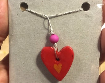 Heart pendant on a sterling silver chain.
