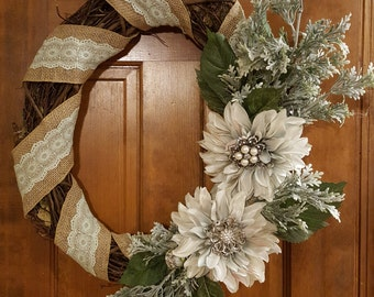 Winter grapevine wreath with mint green flowers and burlap ribbon.