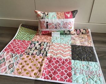 Arrow flight and feathers, modern baby quilt in pink, gold, mint coral.