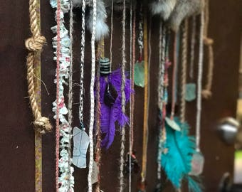 Whimsical  bohemian wind chime with sea glass and feathers!