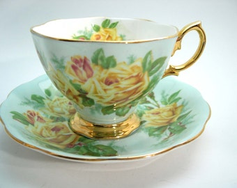 Royal Albert Large Yellow Tea Roses Tea Cup and Saucer, Yellow Roses on Blue tea cup and saucer set.