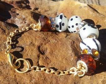 Bracelet with gold chain,Dione style beads in amber, Black and frosted white