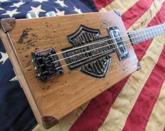 Rustic harley 3 string guitar.